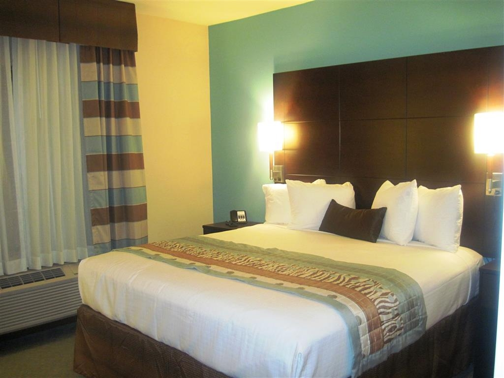 Best Western Plus Midland Suites - Spend a special night together in our king suite.