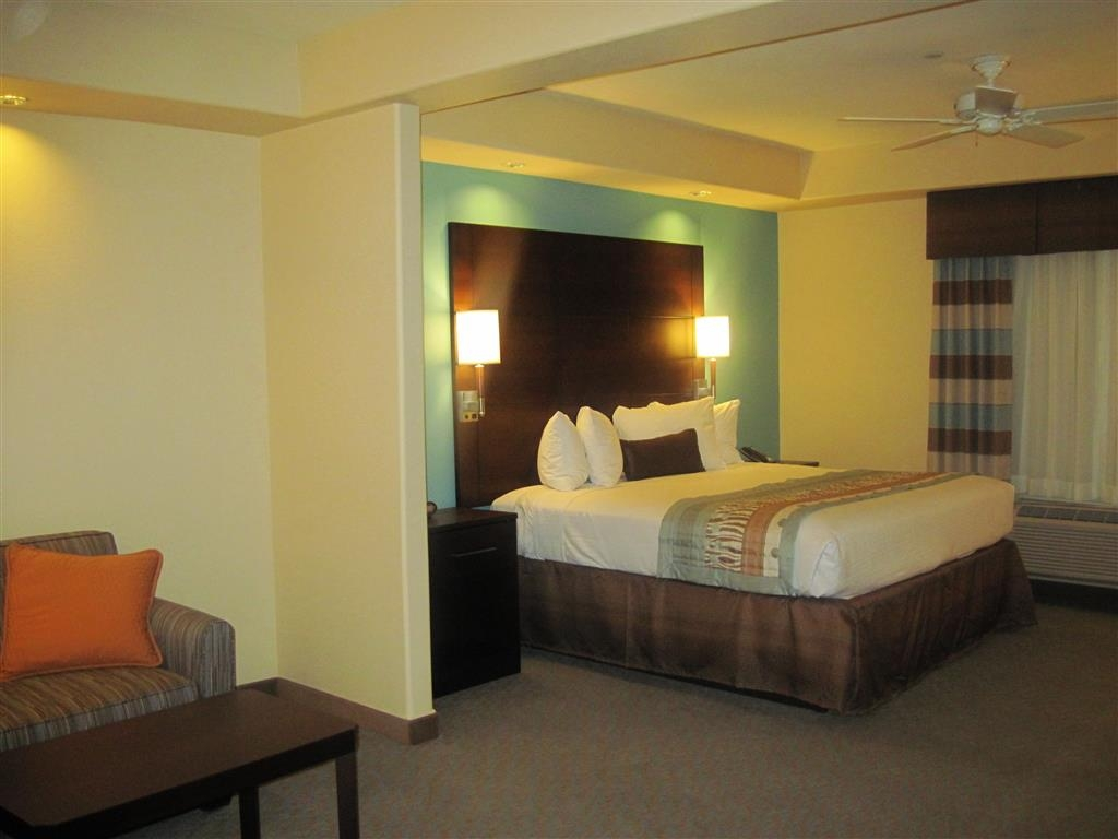 Best Western Plus Midland Suites - Our spacious king suite has all the comforts of home at your fingertips.