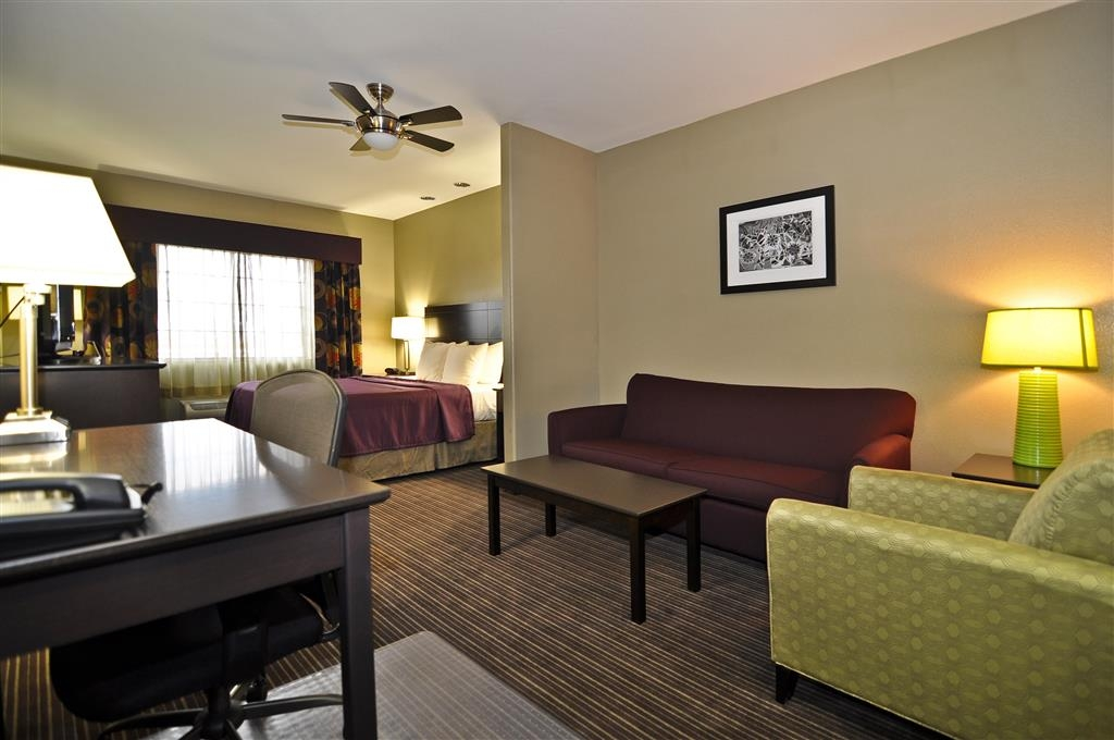 Best Western Giddings Inn & Suites - This spacious king suite offers distinct areas for sleeping, eating and working.