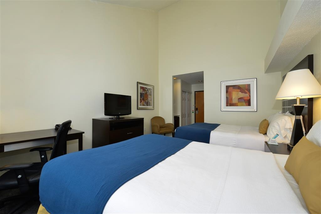 Best Western Plus Rockwall Inn & Suites - This new look of guest room with two double beds has decorative top sheets, pillows & throw and includes a 40-inch LCD TV.
