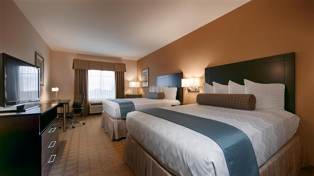 Best Western Plus Lytle Inn & Suites - Relax in our spacious double queen bed rooms.