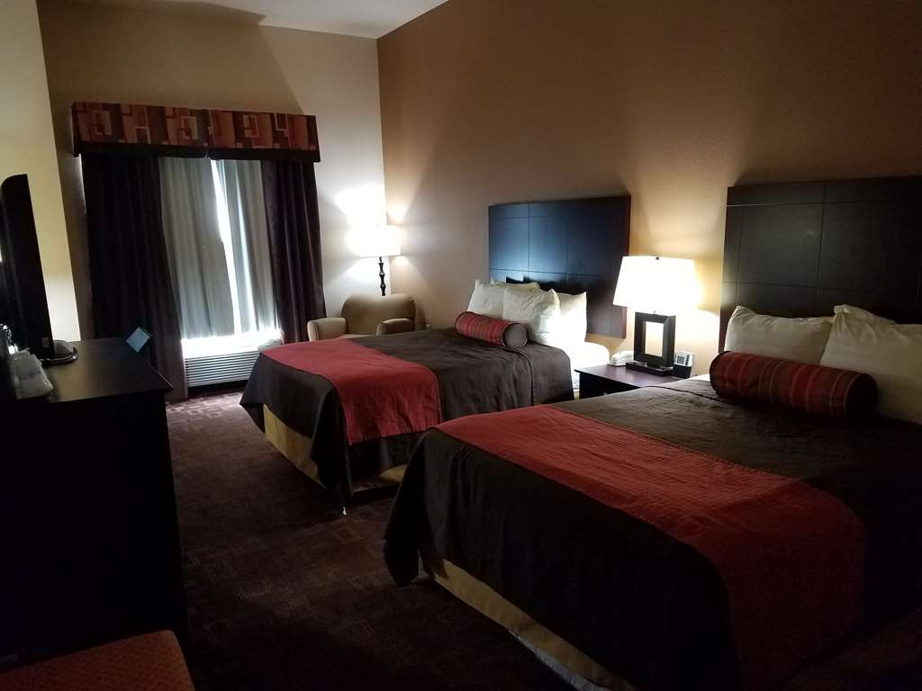 Best Western Plus Goliad Inn & Suites - Wake up completely refreshed in this 2 queen mobility accessible bedroom.