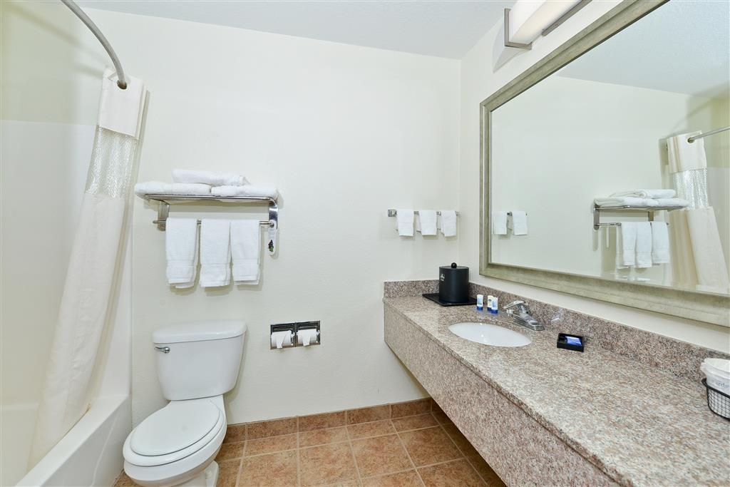 Best Western Plus Orange County - All guest bathrooms have a large vanity with plenty of room to unpack the necessities.