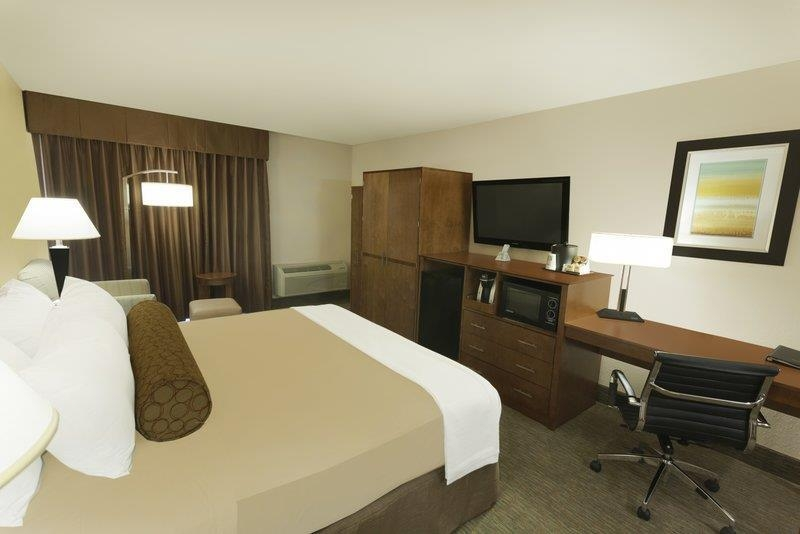 Best Western Plus Atrium Inn - Our spacious king guest room offers all the ammenties of home including a 40-inch LCD TV.