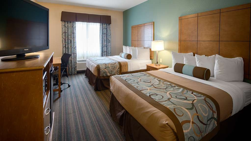 Best Western Plus Seminole Hotel & Suites - Our two queen guest room includes all the amenities of home with 42-inch flat screen TVs, microwave and refrigerator.