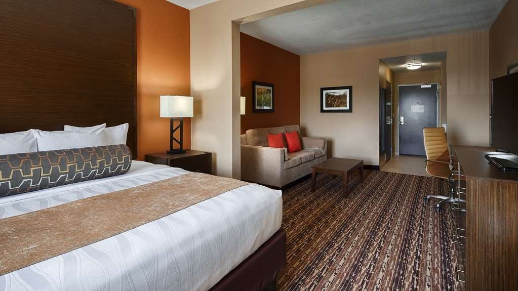 Best Western Plus Elmendorf Hotel - Spend some time after a hectic day in the living room featured in our king suite.