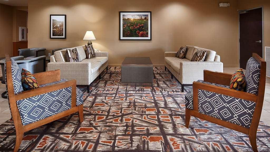 Best Western Plus Elmendorf Hotel - Our hotel lobby is the perfect spot to relax after a long day of work and travel.