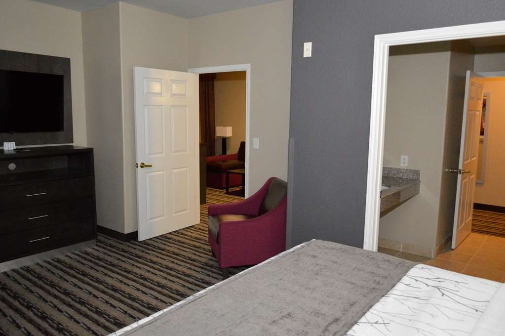 Best Western Boerne Inn & Suites - Two Room King Suite - There is plenty of space for sleeping, eating and working in our two room king suite.