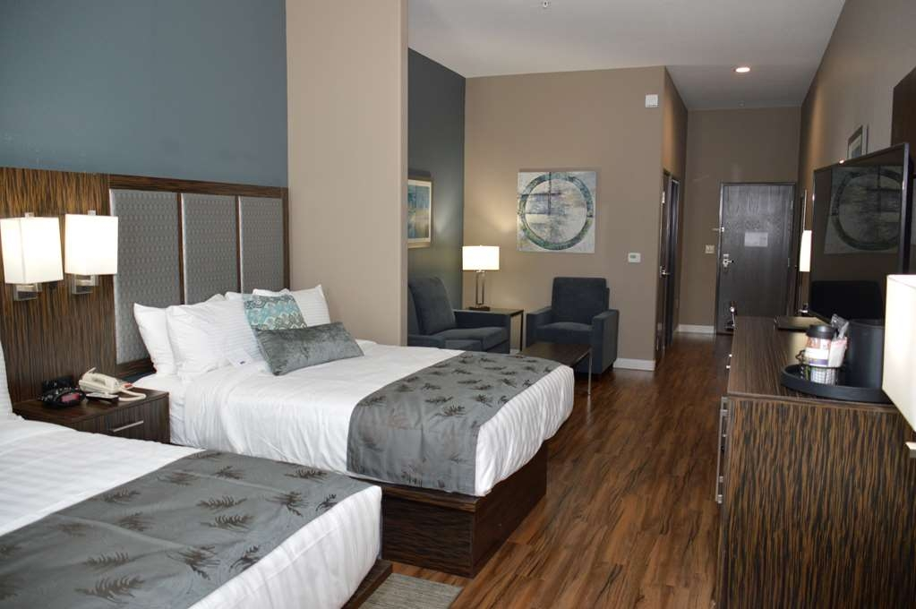 Best Western Plus Pflugerville Inn & Suites - Our Two Queen Suite would be a great choice for your next family reunion group.
