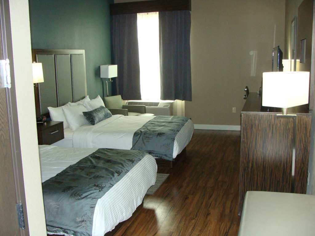 Best Western Plus Pflugerville Inn & Suites - Sink into our comfortable beds each night and wake up feeling completely refreshed.