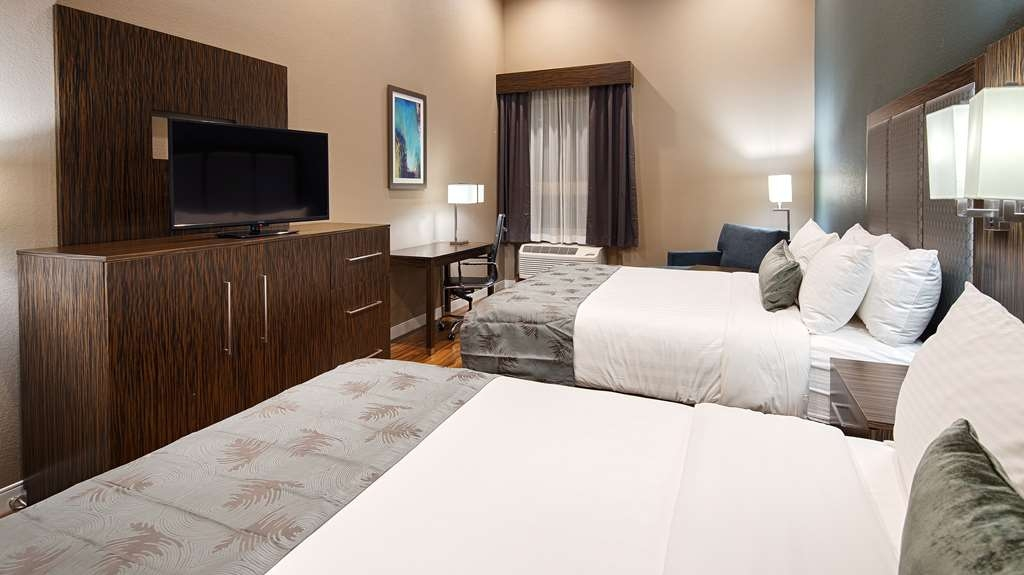Best Western Plus Pflugerville Inn & Suites - Our Two Queen Room is just right for family.