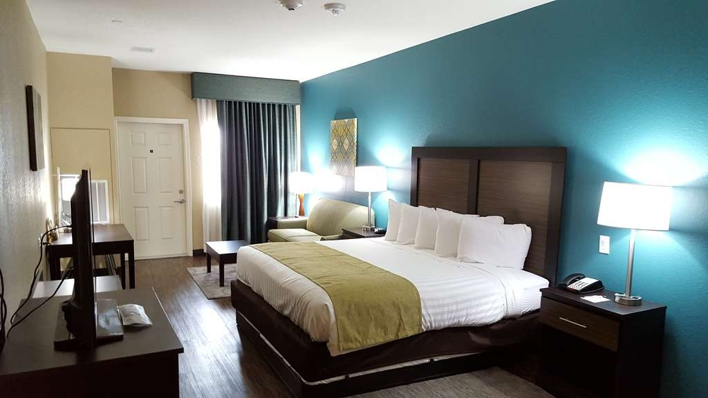 Best Western Plus Galveston Suites - King Suite room containing 1 king bed with a pull out sleeper couch with private balcony overlooking Gulf Mexico.