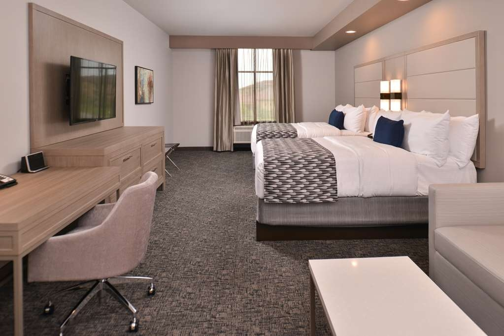 Best Western Premier Energy Corridor - Spacious, upscale guest rooms welcome you with detailed finishes, premium linens, and convenient amenities