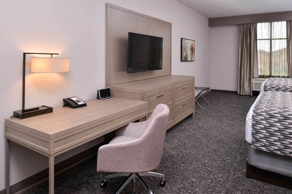 Best Western Premier Energy Corridor - Two Queen Bed with a mini-refrigerator, microwave, Keurig® coffee makers, 49-inch flat screen television, laptop safe, and a pullout sofa sleeper in the separate living room