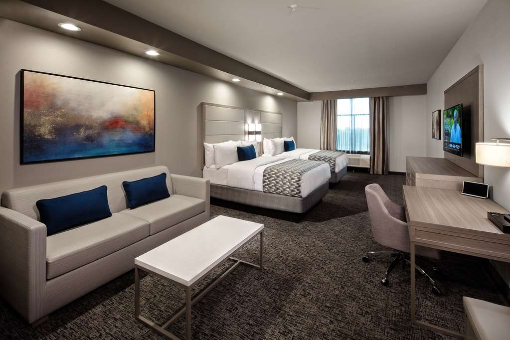 Best Western Premier Energy Corridor - Living area with a mini-refrigerator, microwave, Keurig® coffee makers, 49-inch flat screen television and over 150 channels for your viewing pleasure