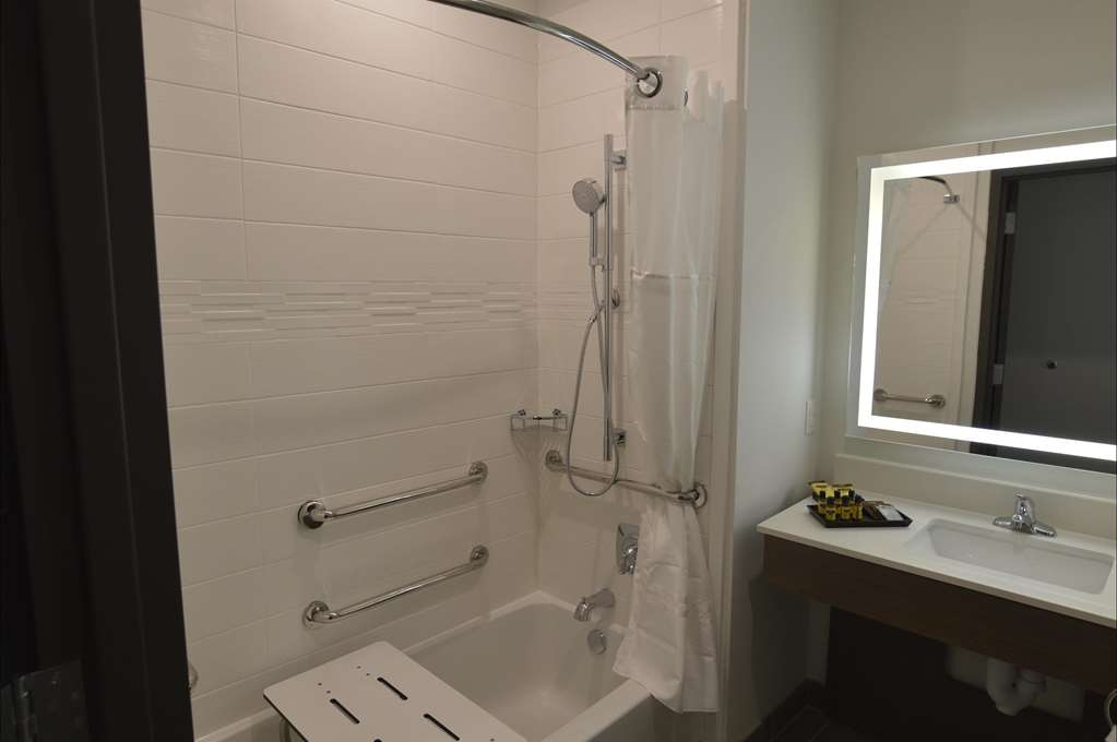 Best Western Plus Executive Residency Austin - From a in bathroom portal tub to grab bars this bathroom offers all the amenities you need.