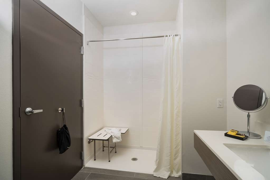 Best Western Plus Executive Residency Austin - We can cater to your needs. Make a reservation in this king mobility accessible suite with a roll in shower.
