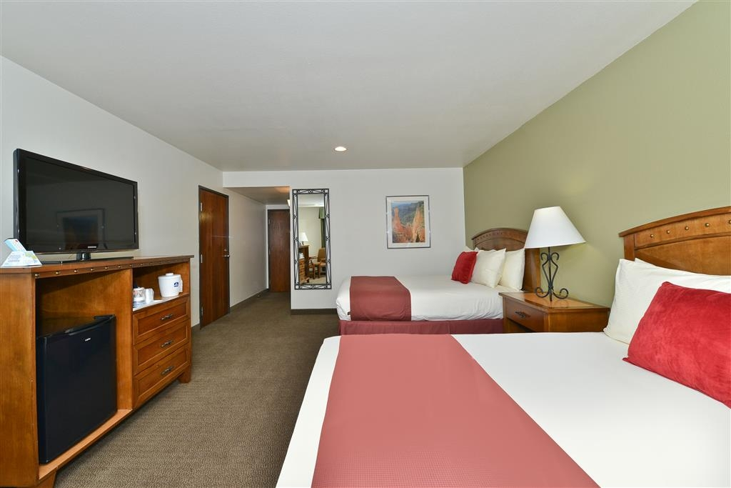 Best Western Red Hills - Our 2 queen bedroom offers a 37-inch HD LCD TV, MP3 alarm clock radio and mini refrigerator.