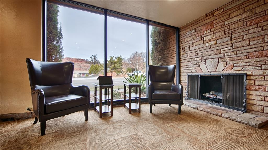 Best Western Red Hills - Relax by the fireplace in our cozy lobby.