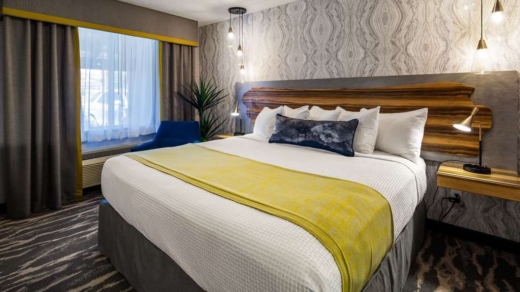 "Best Western Travel Inn - Our modern newly renovated king guest rooms include a 50"" TV with HD channels, wifi, in-room coffee, hair dryer, mini fridge, and microwave."
