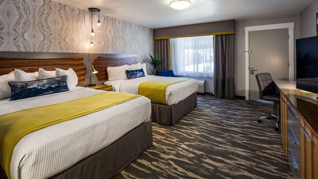 "Best Western Travel Inn - Our modern newly renovated two-queen guest rooms include a 50"" TV with HD channels, wifi, in-room coffee, hair dryer, mini fridge, and microwave."