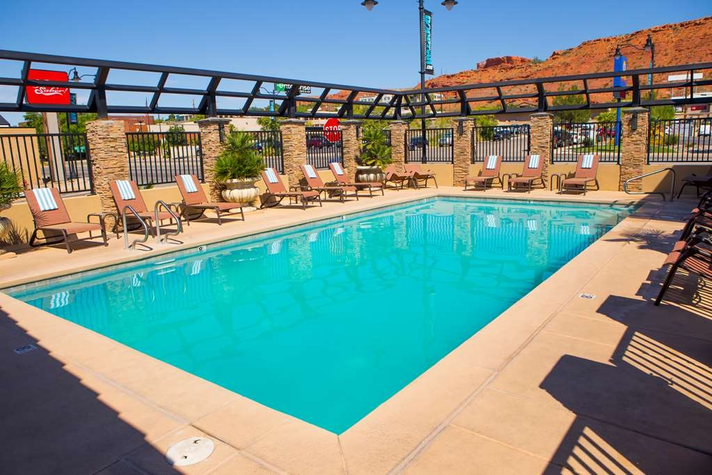 Best Western Travel Inn - Take a relaxing swim in our outdoor heated pool. (seasonal)