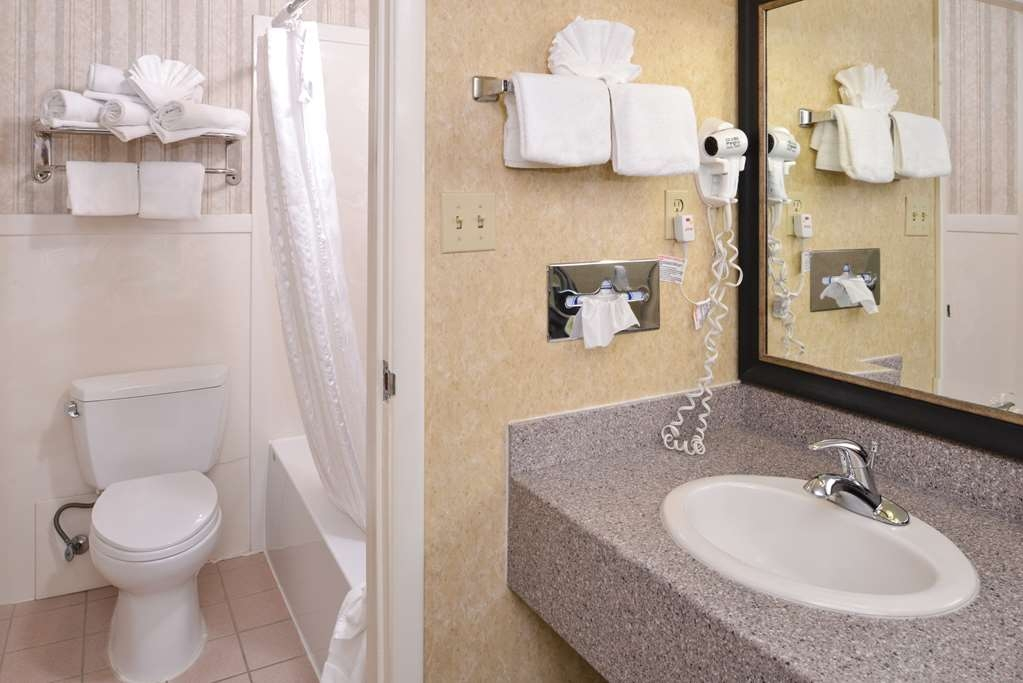 Best Western Coral Hills - All guest bathrooms have a large vanity with plenty of room to unpack the necessities.