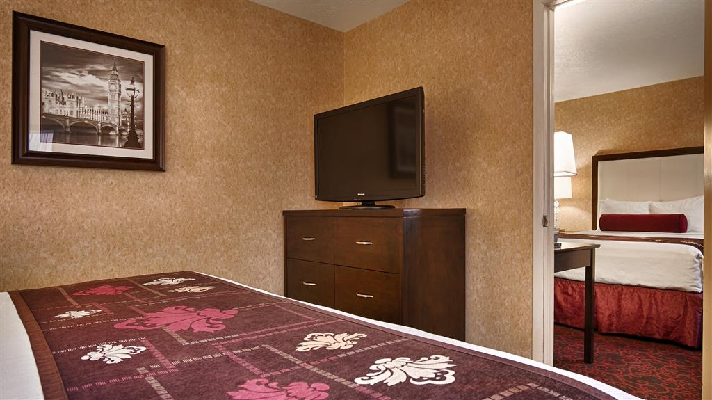 Best Western Coral Hills - Spacious two-room suites with one king bed in one room and two-queens in the other.