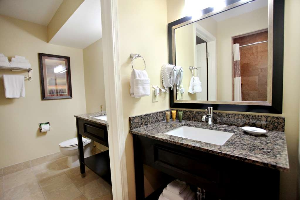 Best Western Plus CottonTree Inn - Our honeymoon suite includes two sinks, two vanities, a jetted tub, walk-in shower and a walk-in closet.