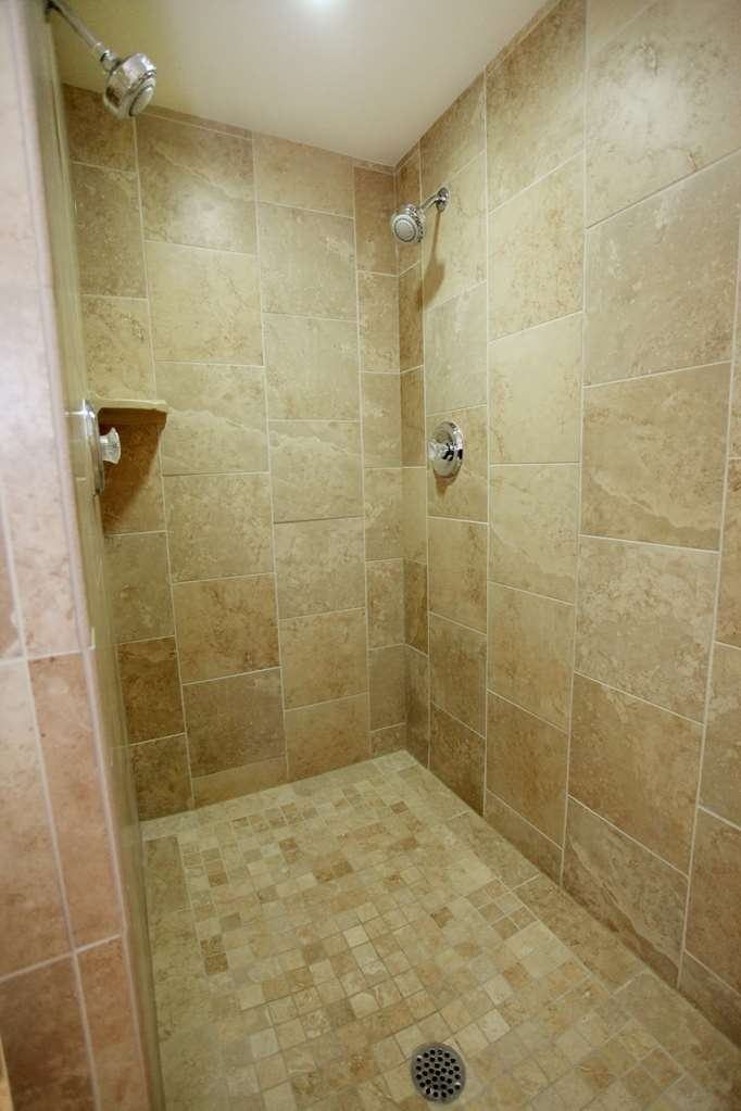 Best Western Plus CottonTree Inn - Our master suite bathroom includes a spacious walk-in shower.