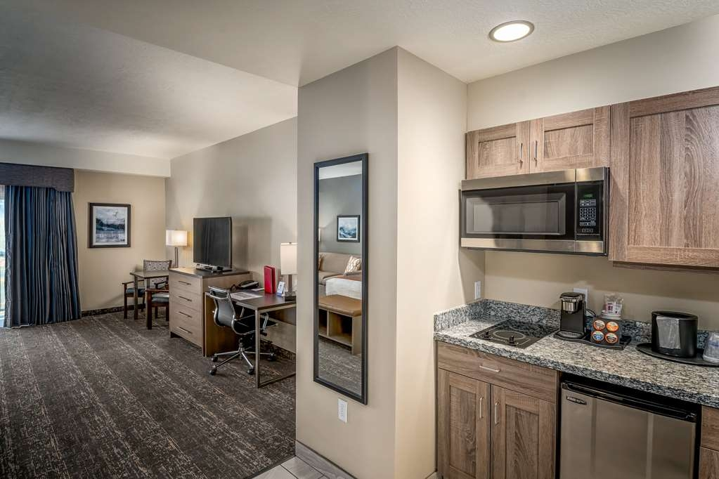 "Best Western Plus Heber Valley Hotel - Sing King Plus - Includes stove cooktop, pots and pans, ceramic dish-ware, cutlery, a balcony, 50"" television, larger square-footage."