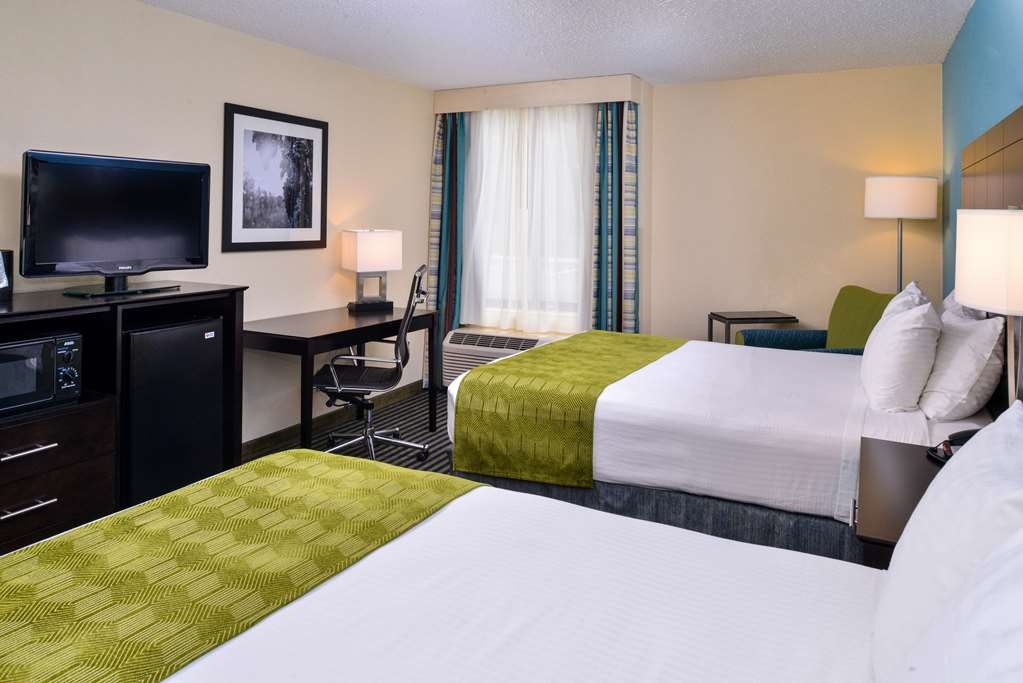 Best Western Leesburg Hotel & Conference Center - Every guest room at the Best Western Leesburg features a refrigerator, microwave, sitting area, large desk, iron and ironing board, and flat screen TV.