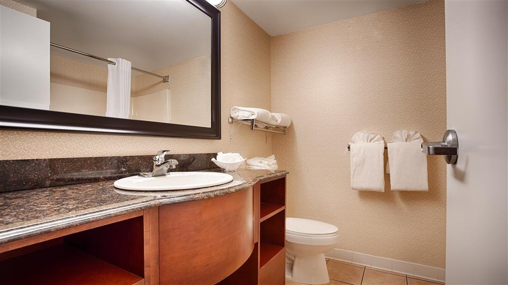 Best Western Plus Inn at Valley View - Spacious bathroom featuring granite countertops, hair dryer, and a special rubber duckie friend to take with you on your travels.