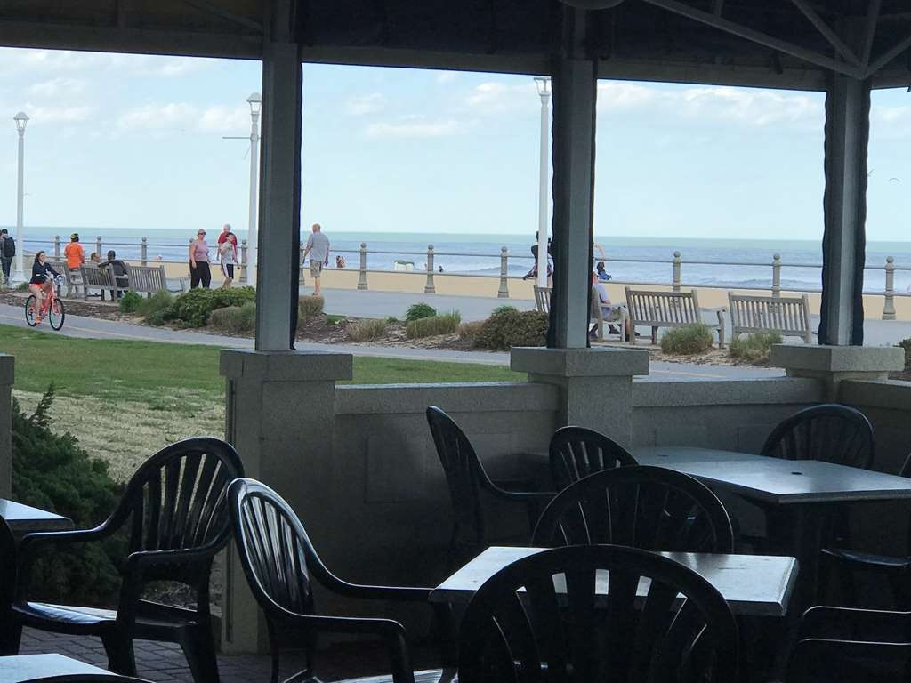 Best Western Plus Virginia Beach - Our Outdoor Patio overlooks the boardwalk and ocean. Open seasonally.