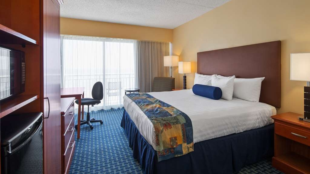 Best Western Plus Virginia Beach - Oceanfront king guest room with private balcony overlooking the water and the Virginia Beach Boardwalk.