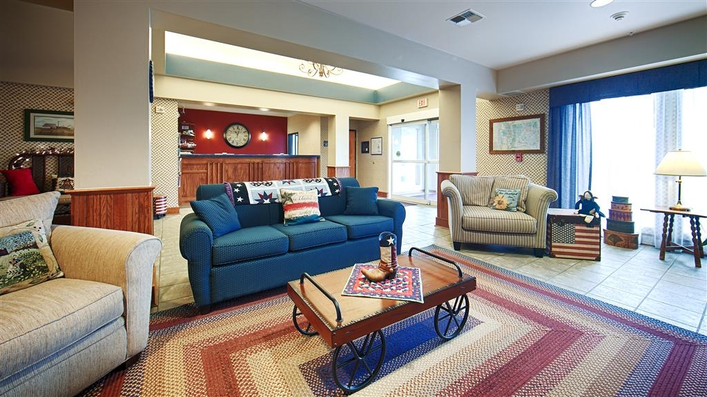 Best Western Bronco Inn - Our lobby is cozy, Americana décor with warm fireplace in sitting area.