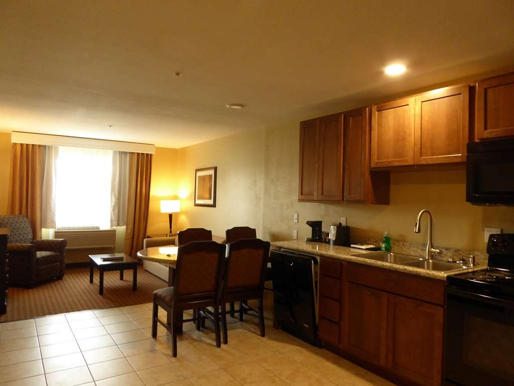 Best Western Plus Vintage Valley Inn - King Spa Suite Bedroom full appliance kitchen, living area & Jacuzzi in bedroom Room 131