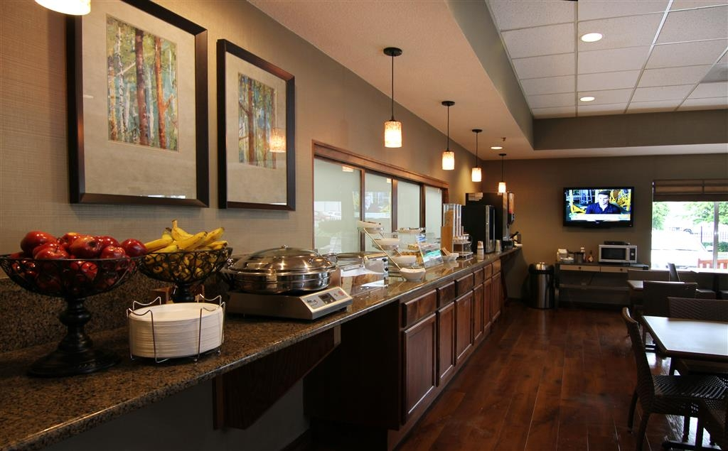 Best Western Plus City Center - Our breakfast bar includes hot eggs, sausage, cinnamon rolls, breads, oatmeal, waffles and pancakes, and much more!