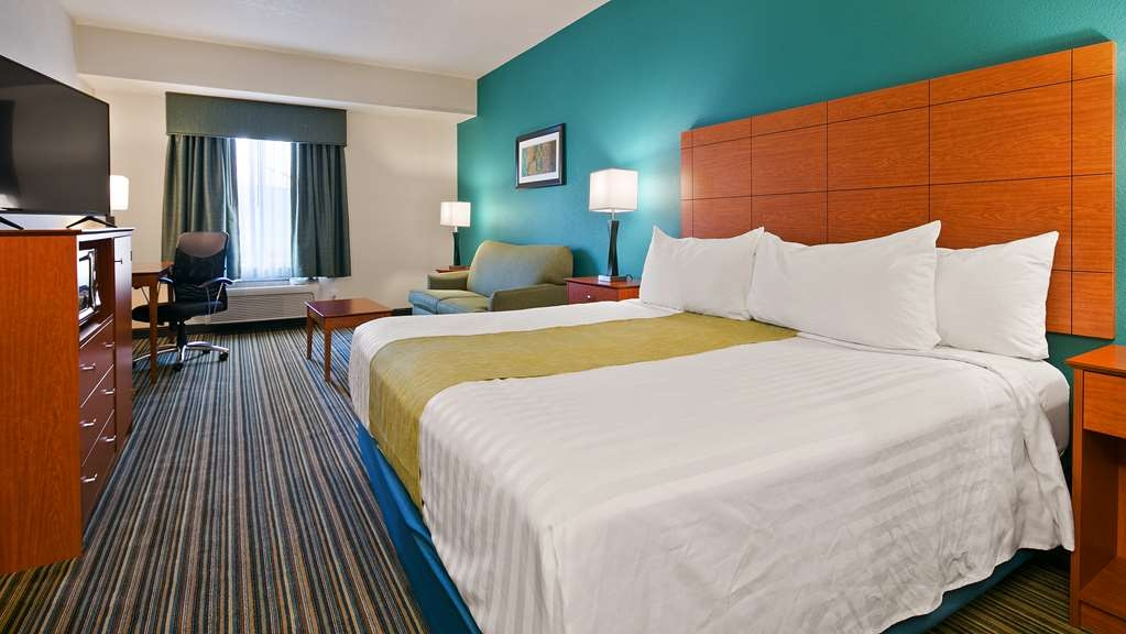Best Western Liberty Inn DuPont - Spacious King room with sofa bed let's you relax or have room for an extra guest.