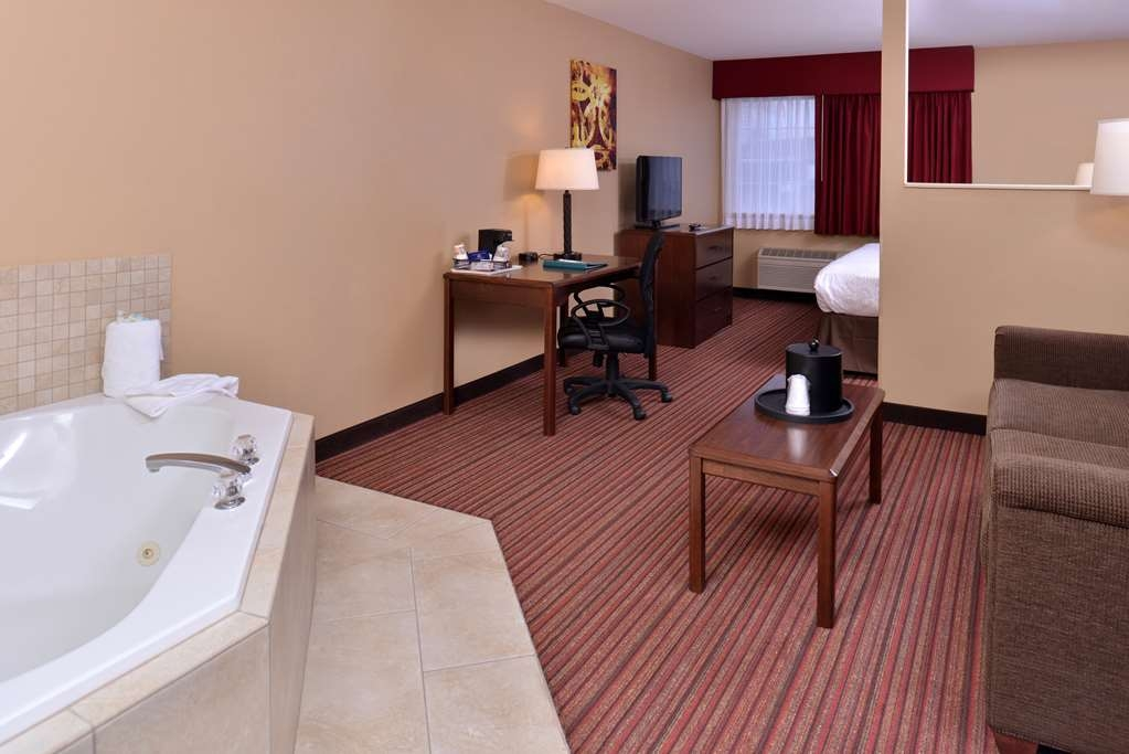 Best Western Woodland Inn - Our king whirlpool tub suite is a perfect place to relax. It offers all the amenities of our suites with add room.