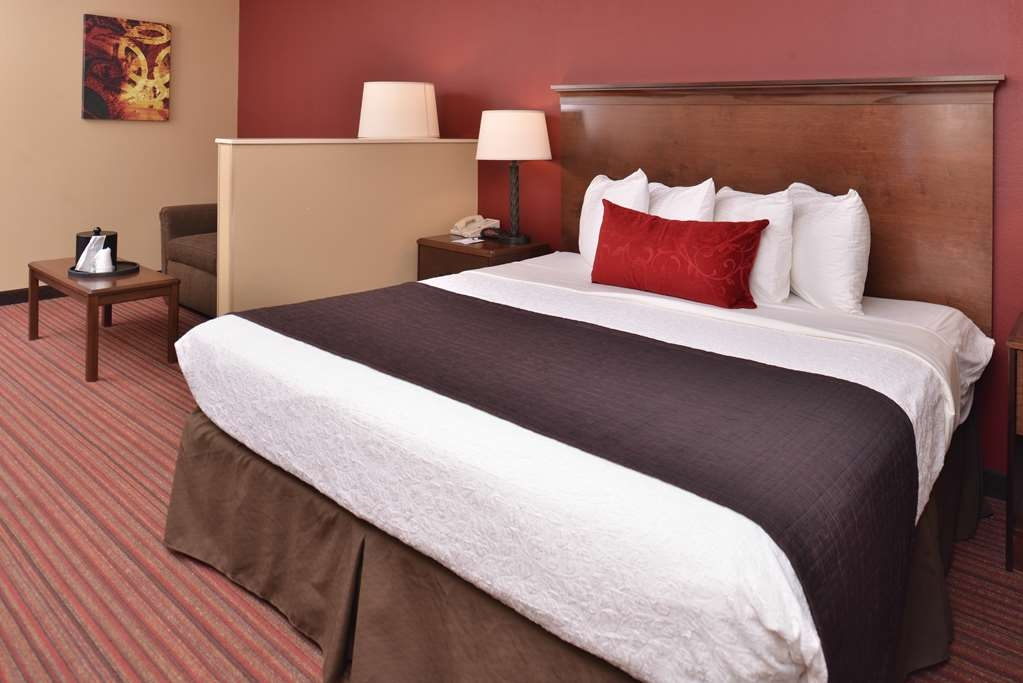 Best Western Woodland Inn - King suite is fully furnished and includes as standard amenities a mini refrigerator, microwave, nightstands with bedside lamps and more!