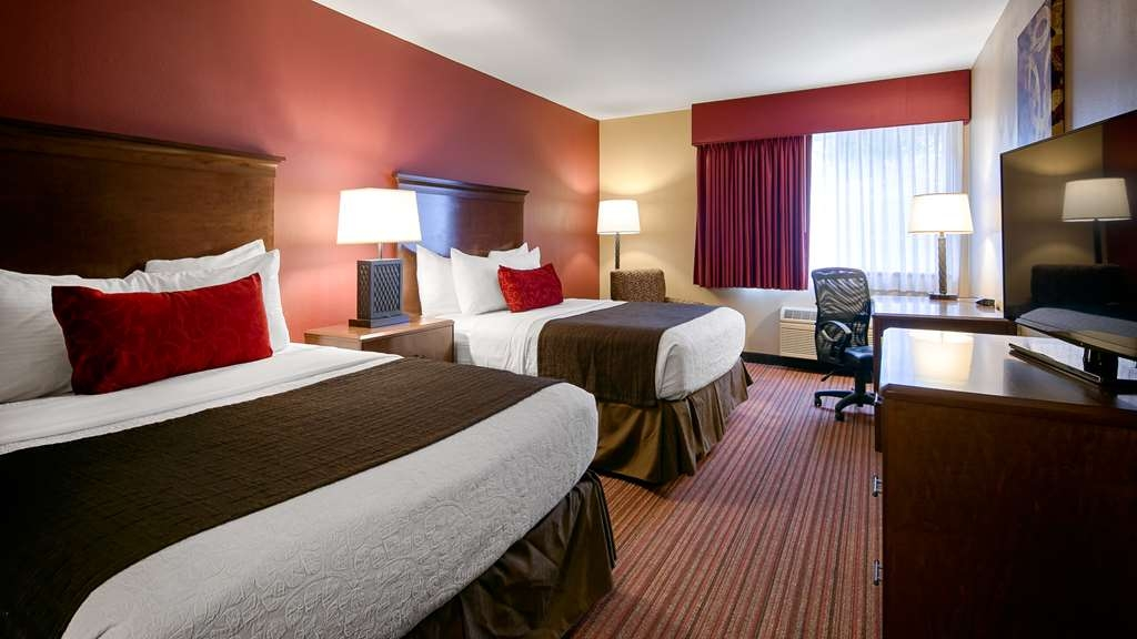 Best Western Woodland Inn - Our standard Double Queen guest room offers the comforts of home with a few added amenities that will make your stay extra special.