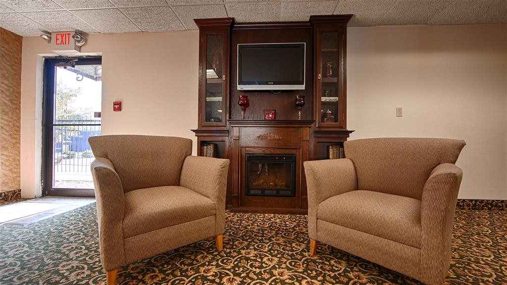 Best Western Huntington Mall Inn - Here in the winter? We will keep you warm by the fireplace in our hotel lobby.