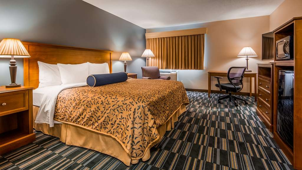 Best Western Inn - Relax after a long day of travel in our king microwave/fridge guest room.