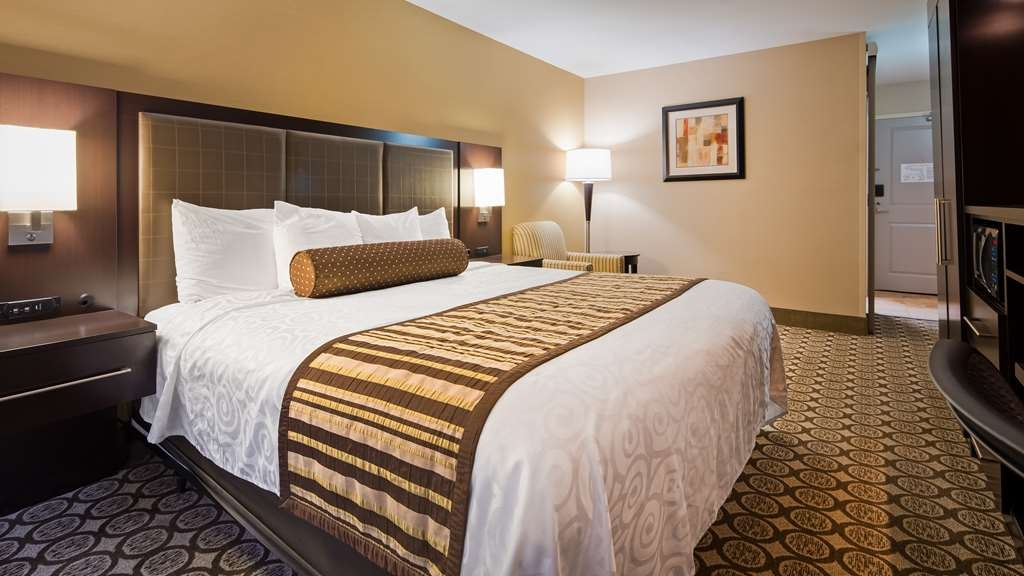 Best Western Plus InnTowner Madison - King room features a pillow top mattress, microwave, mini refrigerator, Keurig® coffee machine, wireless Internet and 42-inch high definition flat screen TV