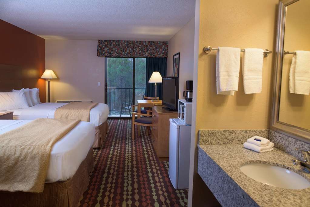 Best Western Ambassador Inn & Suites - Conveniently located overlooking our seasonal outdoor pool, you'll love our spacious two queen room.
