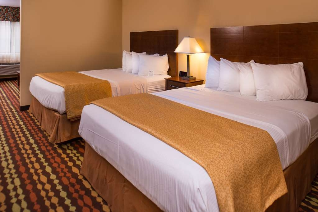 Best Western Ambassador Inn & Suites - Enjoy more room for the family in our Family Room, with 2 Queen Beds and a Queen Sleeper Sofa, divided by a partial wall.