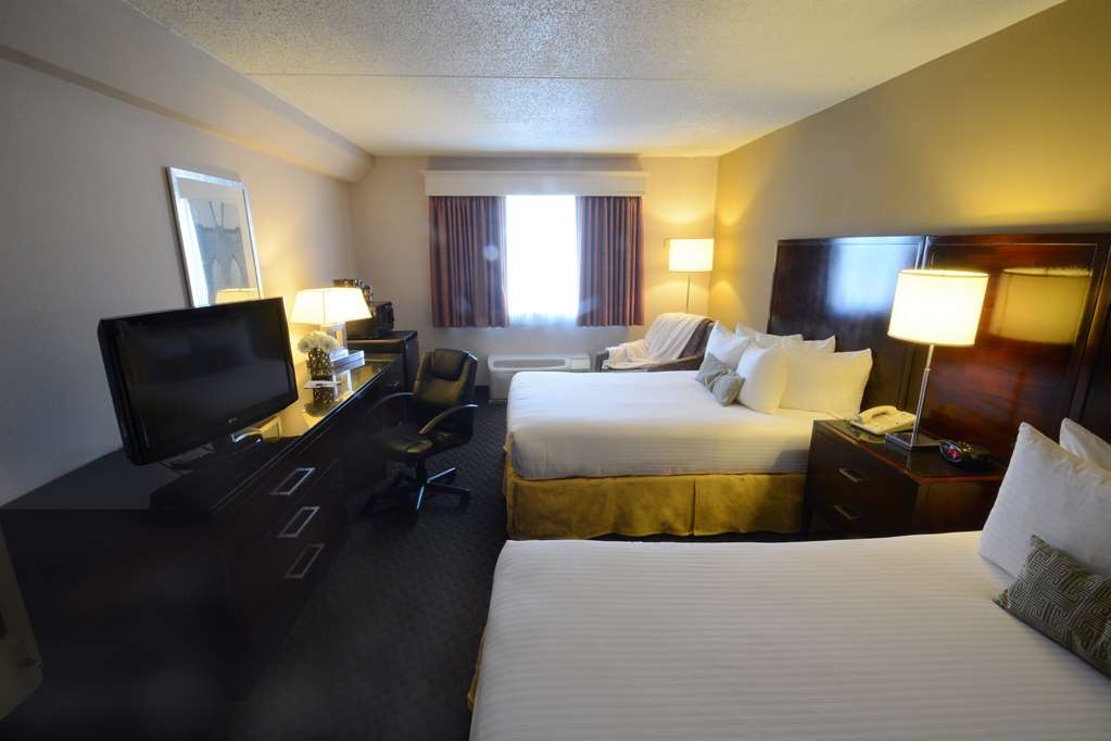 Best Western Riverfront Inn - Our newly renovated (2017) two double beds have complimentary Wi-Fi. Perfect for a weekend getaway, extended stay, or business travel.