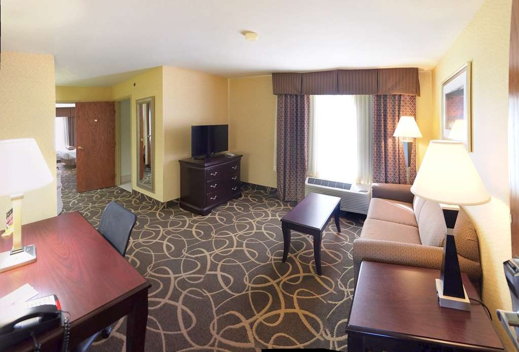 Best Western Plus Eau Claire Conference Center - Use the separate living room in our Double Queen Suite for entertaining, and keep your sleeping area private.