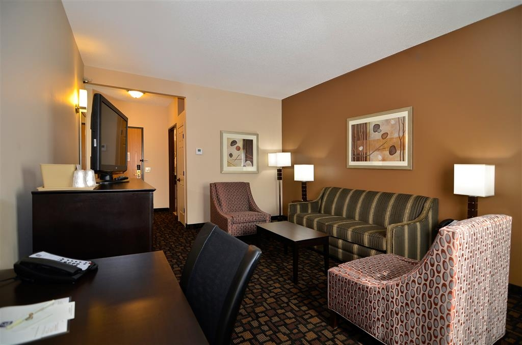 Best Western Plover-Stevens Point Hotel & Conference Ctr - The two-room king suite is ideal for business travelers wanting some extra space or families as well.